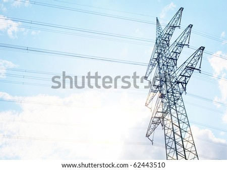 A Power Tower in front of a nice blue summers ky - stock photo