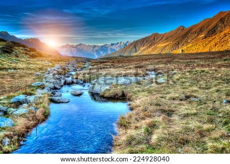 A prairie sunset in mountain - stock photo