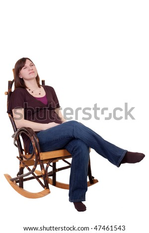 a pregnant mother resting in a rocking chair