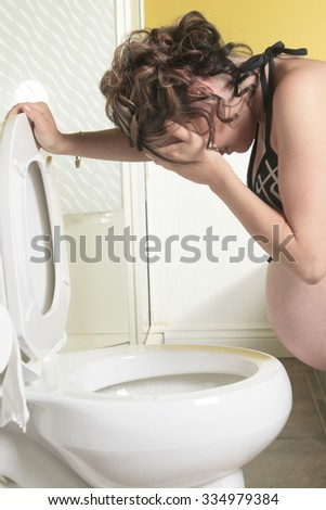 A Pregnant woman having morning sickness during Pregnancy. Concept photo of pregnancy, pregnant woman lifestyle and health care.copyspace - stock photo