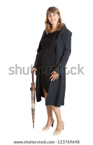 A pregnant woman (9 months) with a umbrella - stock photo