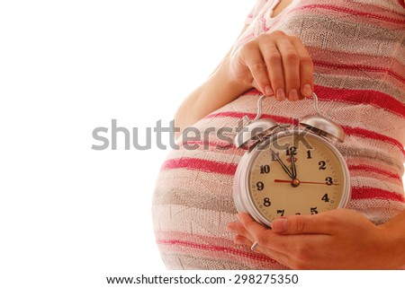 a Pregnant woman with an alarm clock on a white background - stock photo