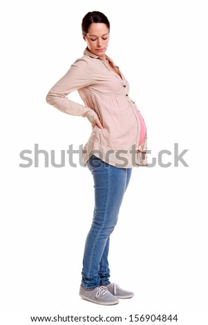 A pregnant woman with her hands on her back, isolated on a white background. - stock photo