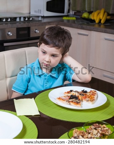 A preschool boy who is not interested in food - stock photo