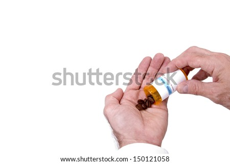 A prescription bottle of coffee beans and male hands as a metaphor for caffeine as a drug.