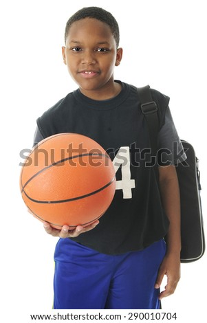 A preteen athlete carrying his gym bag while holding out his basketball in an invitation to play.  On a white background. - stock photo