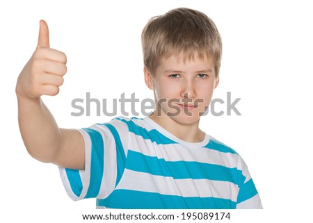 A preteen boy holds his thumb up on the white background - stock photo