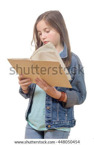 a preteen girl reads a book isolated on white background - stock photo