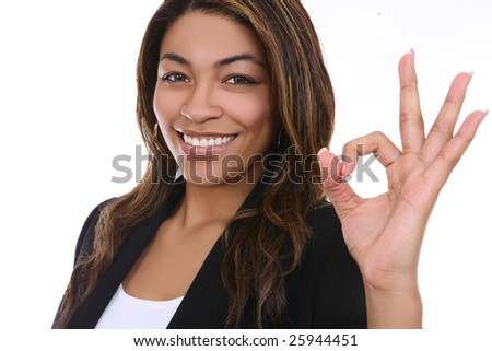 A pretty african american business woman indicating success