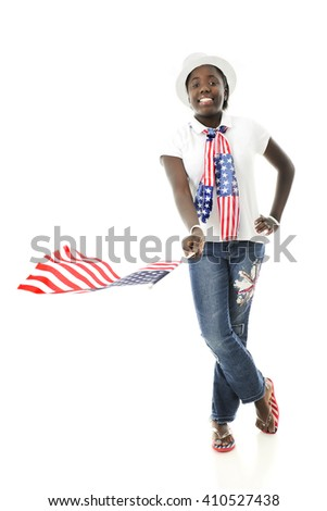 A pretty African American tween waving the American flag while proudly wearing the stars and stripes.  On a white background. - stock photo