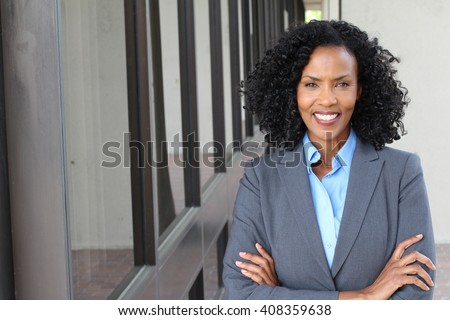 A pretty African american woman at work - stock photo