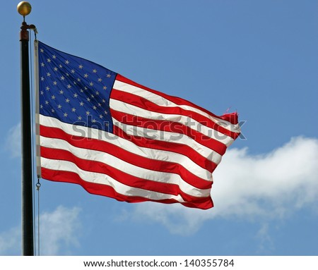 A pretty American flag waving in the wind - stock photo