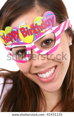 A pretty, and young birthday girl with colorful accessories