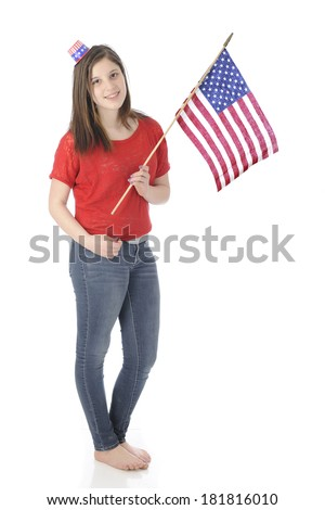 A pretty, barefoot young teen carrying an American flag while wearing a tiny Uncle Sam hat.  On a white background. - stock photo