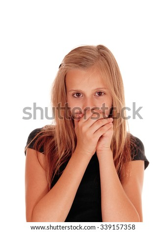 A pretty blond slim girl holding her hands over her mouth, looking