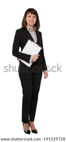 A pretty businesswoman carrying an empty clipboard - stock photo
