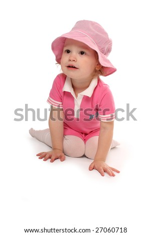 A pretty child in pink dress and pink hat