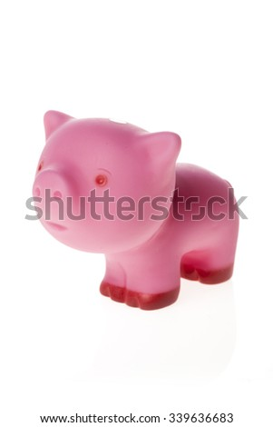 A pretty(cute) doll of pink pig made in rubber isolated white