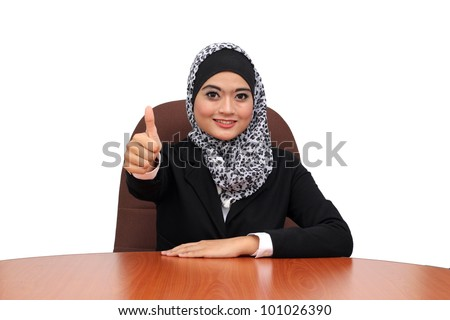 A pretty diverse young muslim business woman hold thumb up - stock photo
