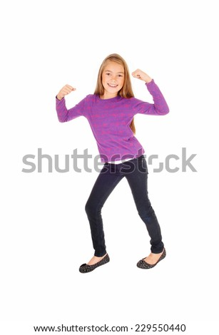 A pretty eight year old girl in jeans and a sweater dancing, isolated on white background.  - stock photo