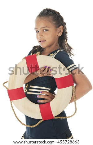 A pretty elementary girl in a sailor dress.  She's looking the the viewer while holding a life ring.  On a white background.