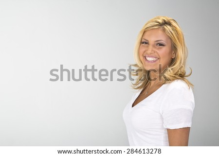 A pretty ethnic blonde model posing in a studio environment.   - stock photo