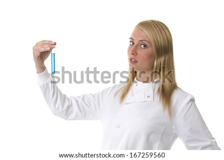 A pretty female lab technician looking at a test tube, isolated on white