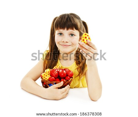 A pretty girl happy with her Easter eggs. Isolated on white background