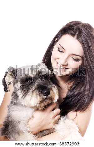 A pretty girl holding her Miniature Schnauzer and smiling on a white background. Copy space above.