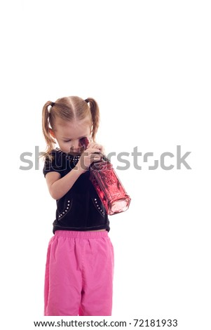 A pretty girl looking into a bottle.  The photograph is isolated on white. - stock photo