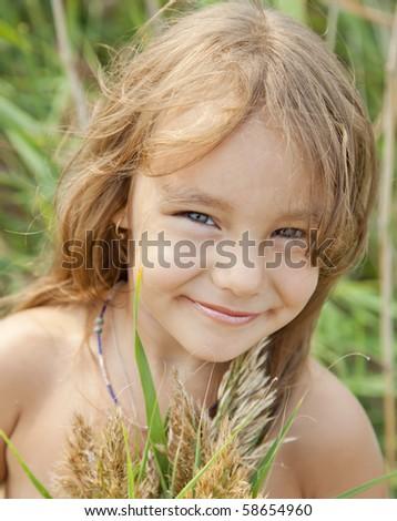 A pretty girl smiles cheerfully - stock photo
