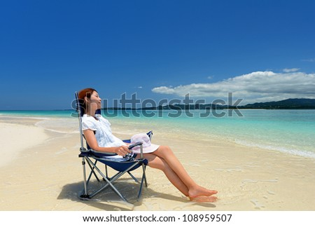 A pretty happy young woman enjoying at a beach