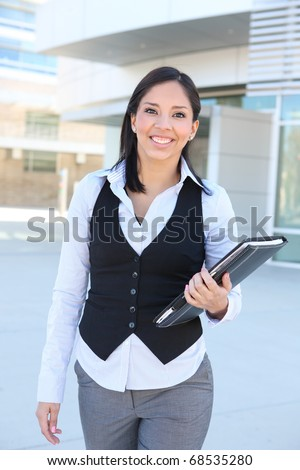 A pretty hispanic business woman walking at office
