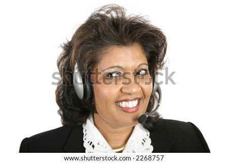 A pretty Indian customer service agent wearing a headset.  Isolated on white. - stock photo