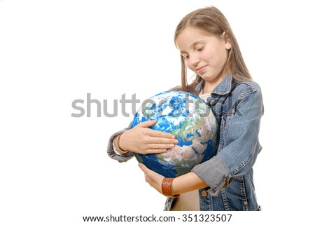 a pretty little girl holding the Planet Earth