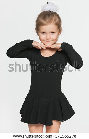 A pretty little girl prepares for dancing - stock photo