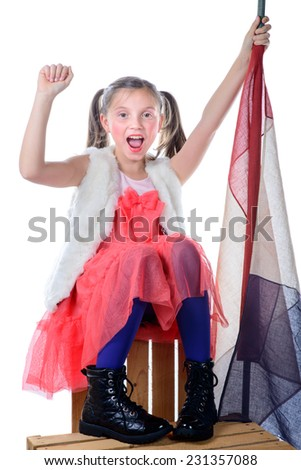 a pretty little girl sitting on a box with a french flag on the white background