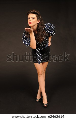 A pretty pin up girl in a sexy secretary outfit. - stock photo