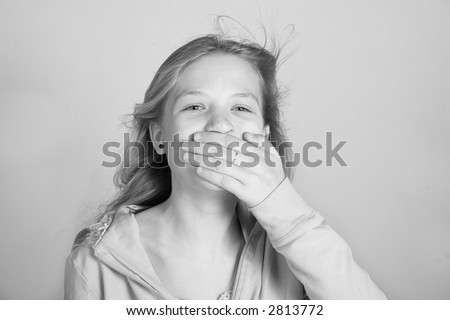 A pretty teen girl who is surprised by something. - stock photo