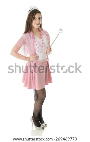 "A pretty teen ""princess"" happily standing  in her crown and with the scepter.  On a white background."