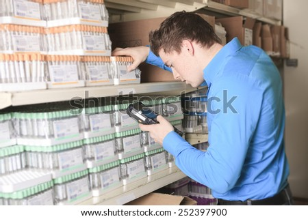 A Pretty warehouse manager checking the inventory - stock photo
