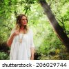 a pretty woman in a thicket toned with a soft glowing filter (soft focus) - stock photo