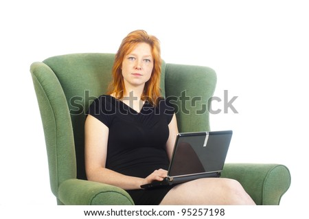 a pretty woman is working at home - stock photo