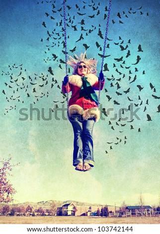 a pretty woman on a swing - stock photo