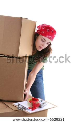 A pretty woman picking up boxes while working - stock photo