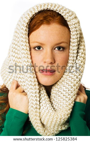 A pretty woman with red hair and freckles with a scarf wrapped around her head. - stock photo