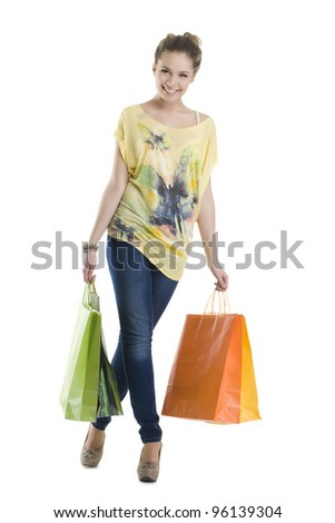 A pretty woman with shopping bags - stock photo