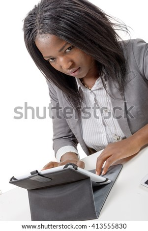 a pretty young african american woman with a tablet computer