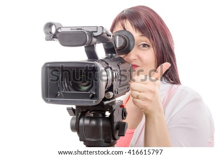 a pretty young camerawoman with a professional camera, on white