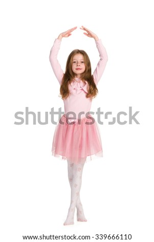 A pretty young girl is dancing on the white background - stock photo